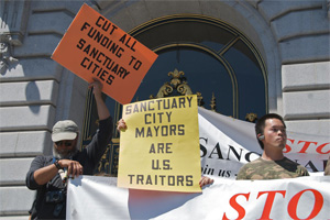 Signs at sanctuary cities protest