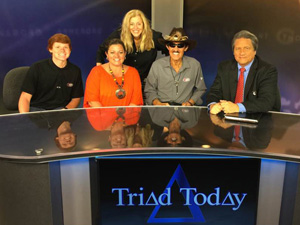 Richard Petty on the set of Triad Today with daughter Rebecca, grandson Thad, host Jim Longworth, and Jim's wife Pam Cook