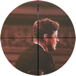 John F Kennedy pictured in rifle crosshairs