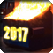 A dumpster on fire with the year 2017 on the front