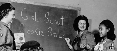 Historical photo of girl scouts planning cookie sales