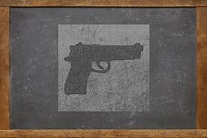 Drawing of a gun on a blackboard