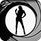 silhouette image of a smart-dressed woman holding up a handgun inside the famous James Bond opening sequence gun barrel