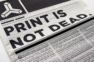 A newspaper with headline declaring 'Print is not dead'