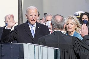 Joe Biden taking the oath of office for the US presidency