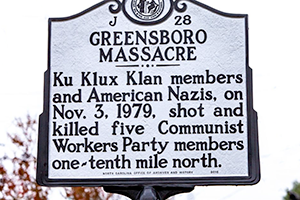 The historical marker sign for the Greensboro Massacre